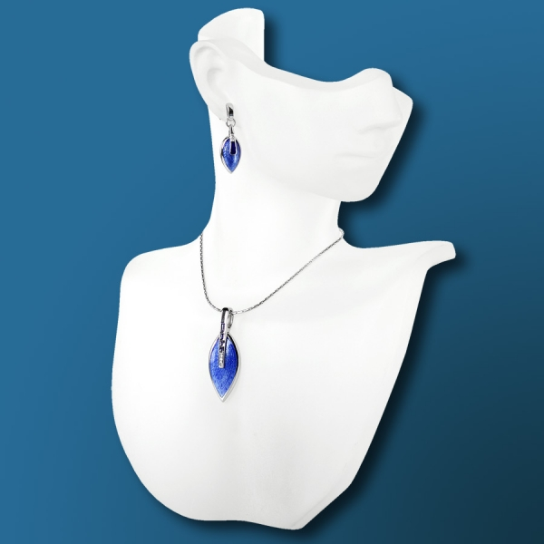 Nicole Barr silver earrings and necklace in cobalt blue.
